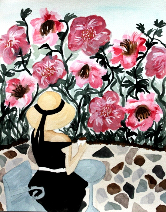 Woman sitting on patio looking at flowers
